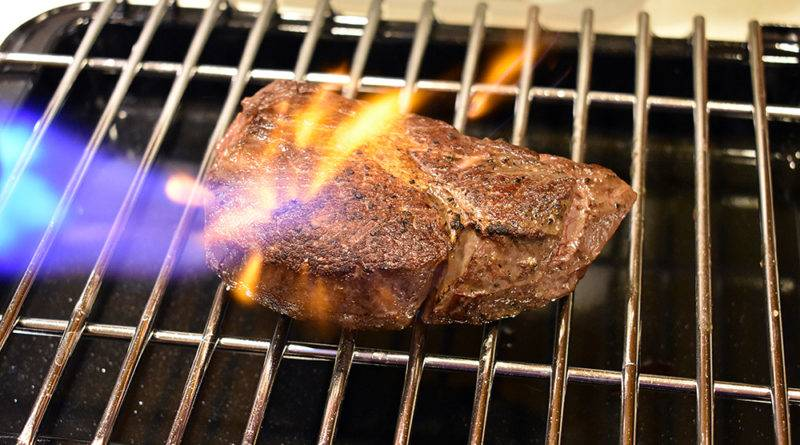 searing steak with torch