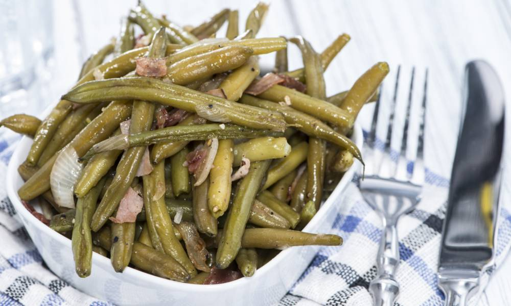 Sous vide green beans are delicious when combined with diced bacon.
